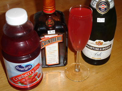 Put triple sec and cranberry juice into a Champagne flute. Add in ...